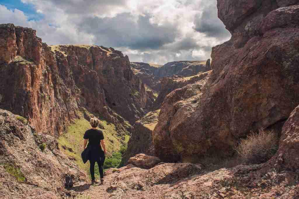 Woman overlooking canyon.