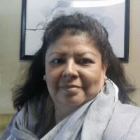 Headshot of Dina Flores Brewer